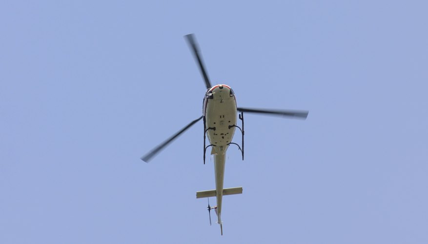 Rotor blades provide lift and allow the helicopter to climb and descend vertically.
