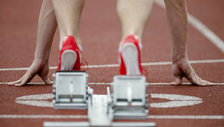 Close-up of a runner's feet on a track.