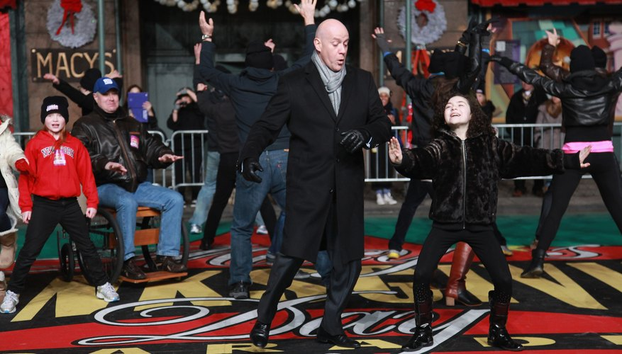 Anthony Warlow as Daddy Warbucks dances with the cast of