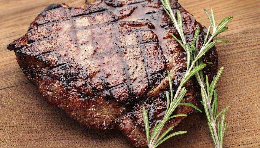 A grilled steak on a cutting board.
