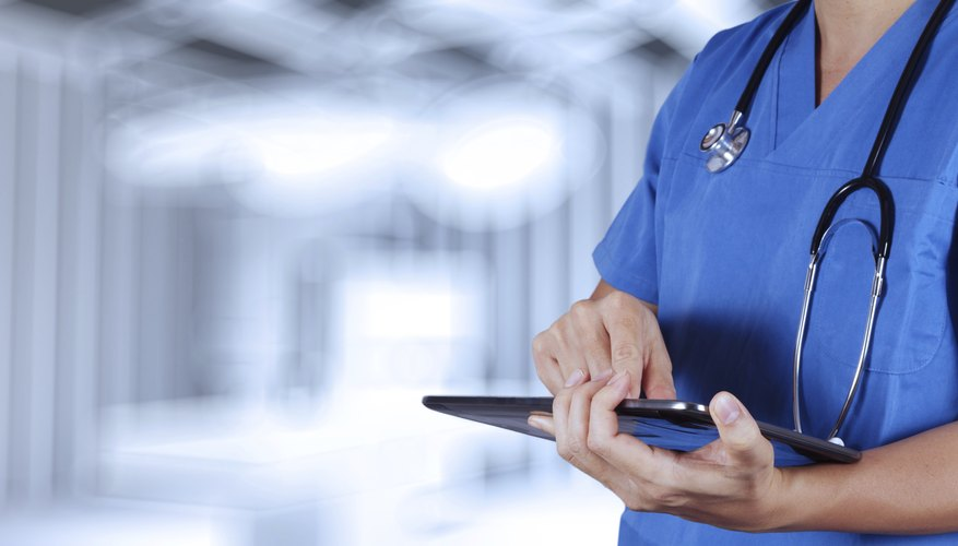 Close-up of hospital employee using tablet