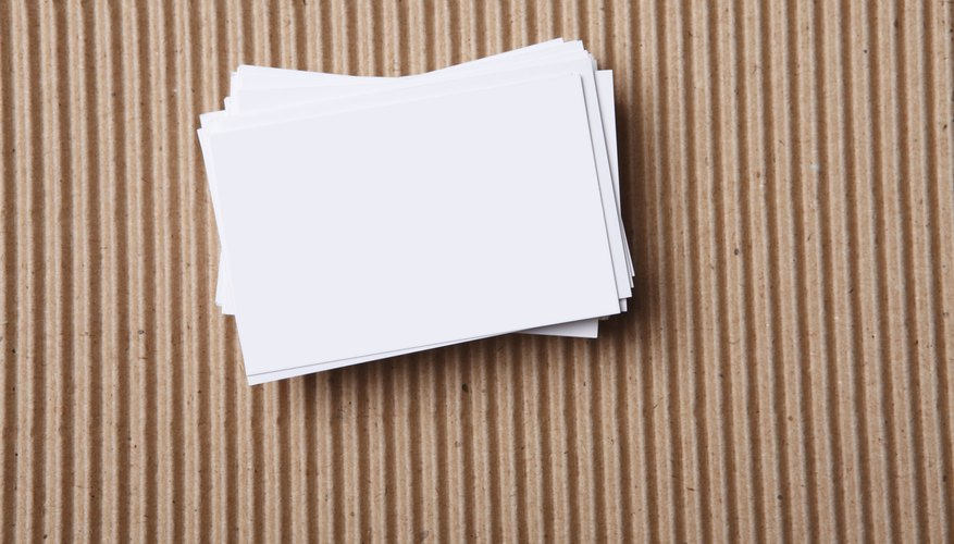 A stack of index cards laying on a table.