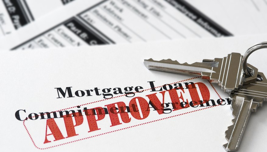 An approved mortgage loan application with keys to a house.