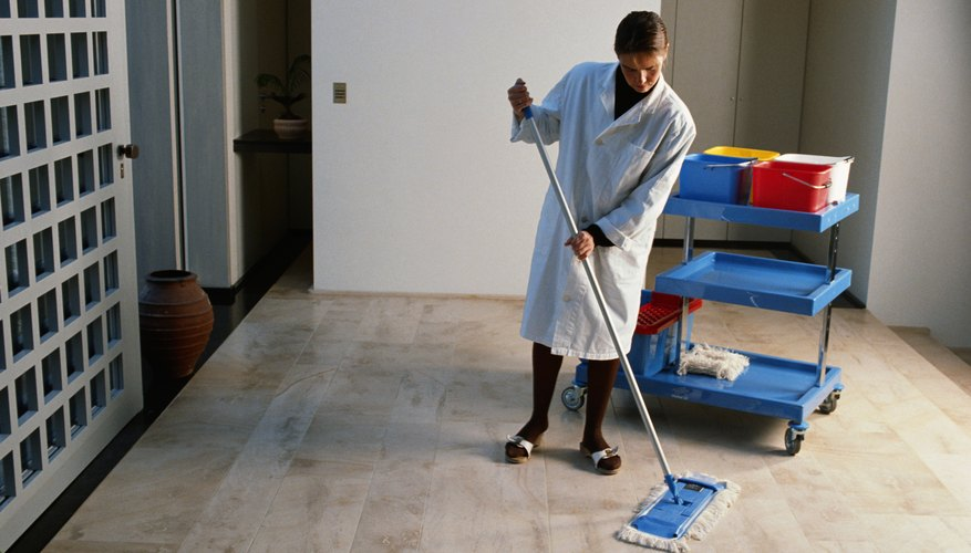 Woman mopping hotel lobby
