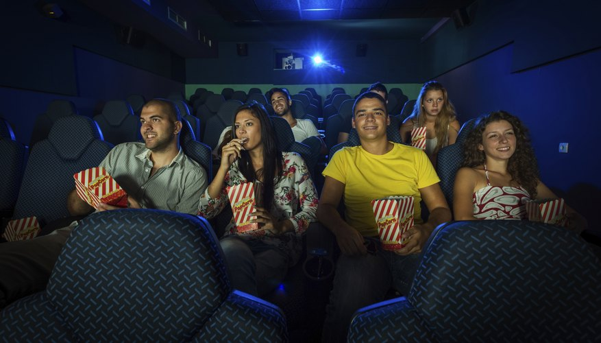 Theatre of people watching movie screen