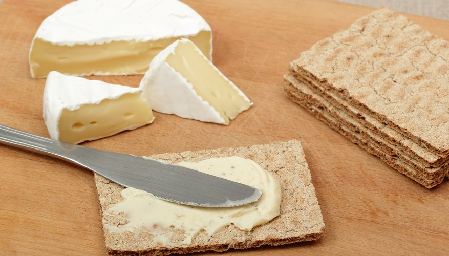 Brie and crackers on a wooden surface