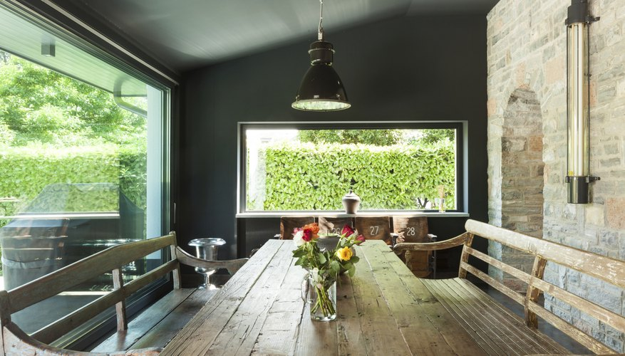 A rustic dining room with handcrafted wood furniture.