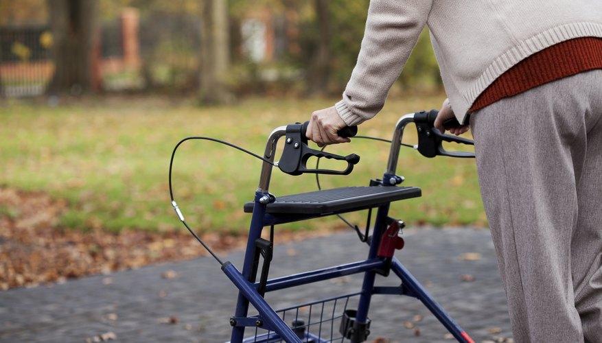 An elderly woman uses a walker.