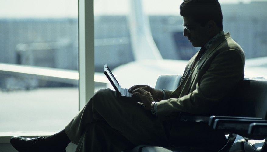 Businessman using laptop at airport