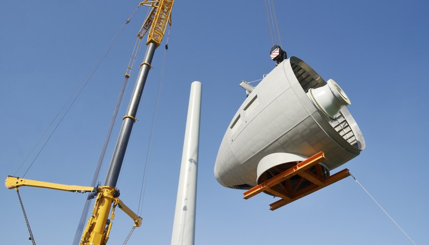Mobile crane picking up gear equipment for wind turbine