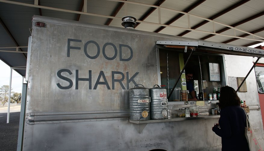 A food truck helping a customer