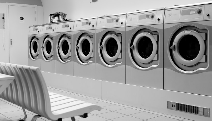 Salary for an owner of a laundromat bizfluent row of industrial washing machines in a public laundromat solutioingenieria Gallery