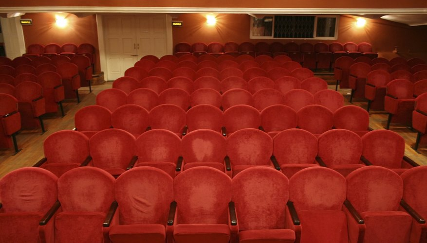 Old theater with worn red seats