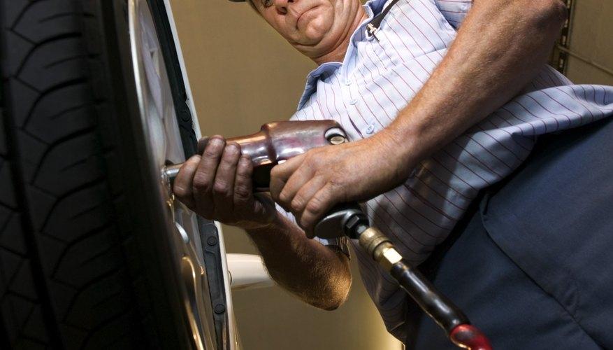 Mechanic tightening lug nuts on car tire