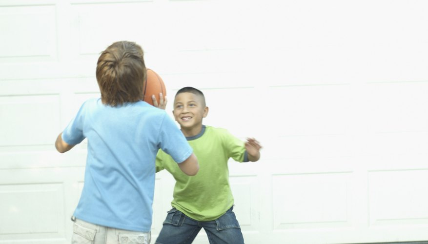 Children can play basketball on their own or on a team.