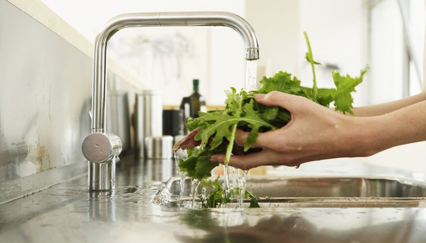 Woman washing arugula