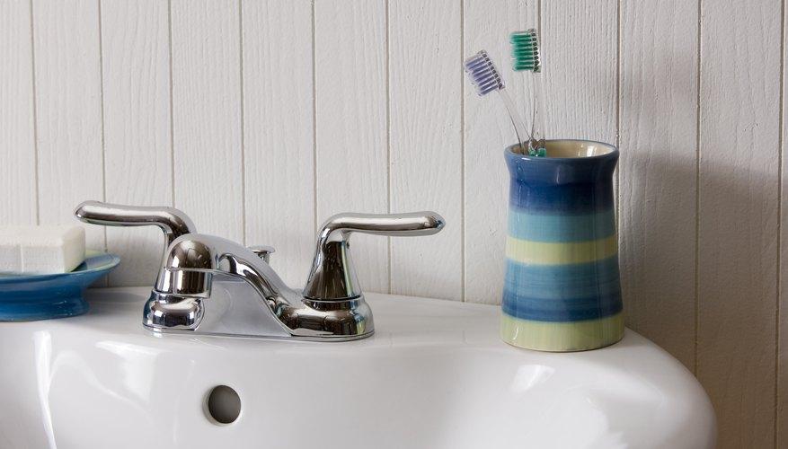 Toothbrushes on bathroom sink