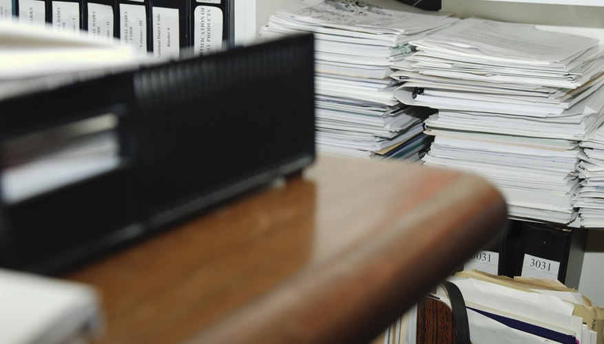 Piles of documents in office