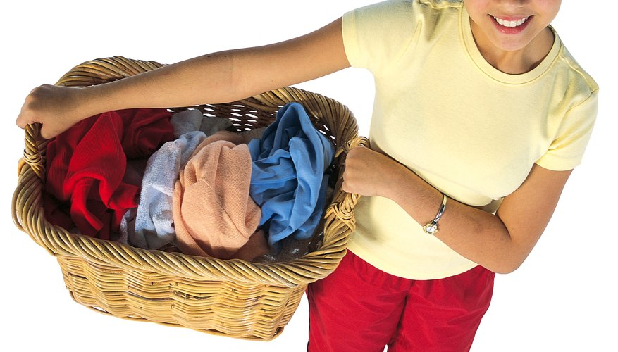 Teaching teens chores like doing laundry will help them be more self-sufficient at graduation.