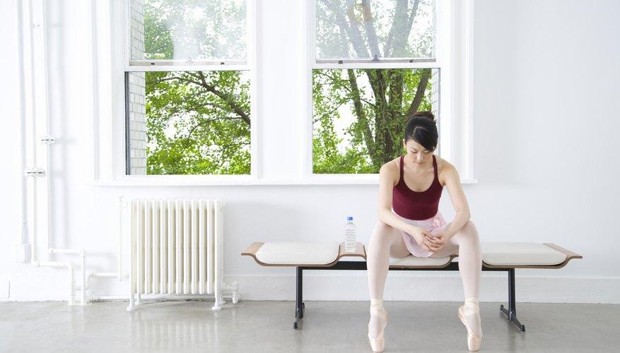Young ballerina sitting in her studio