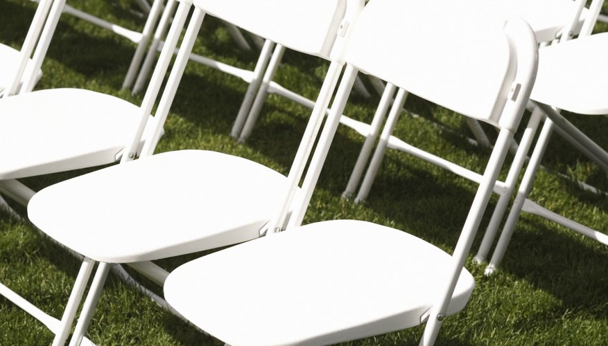 Covering folding chairs makes weddings more festive.