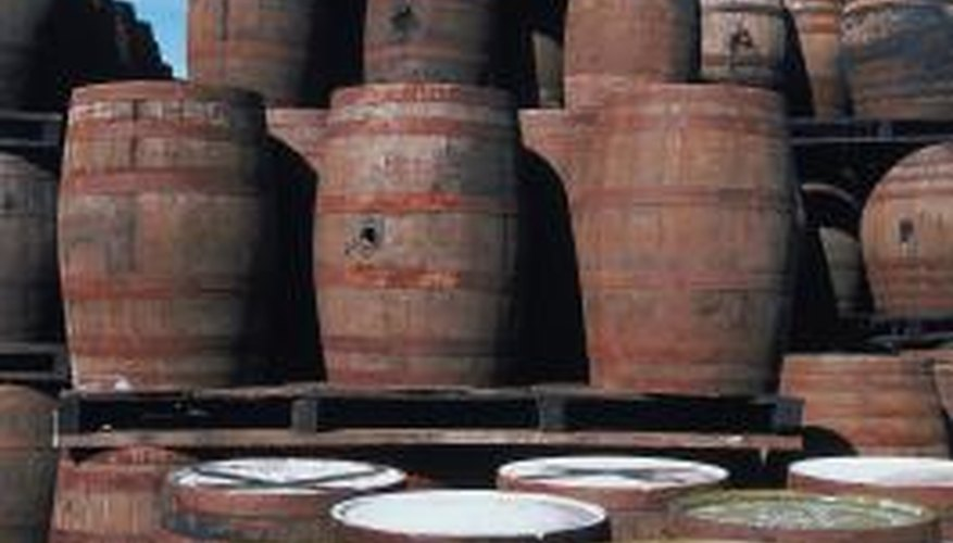Whiskey barrels are plentiful and make interesting and effective barbecue grills.