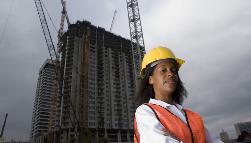 Portrait of a female architect standing in front of a building under construction