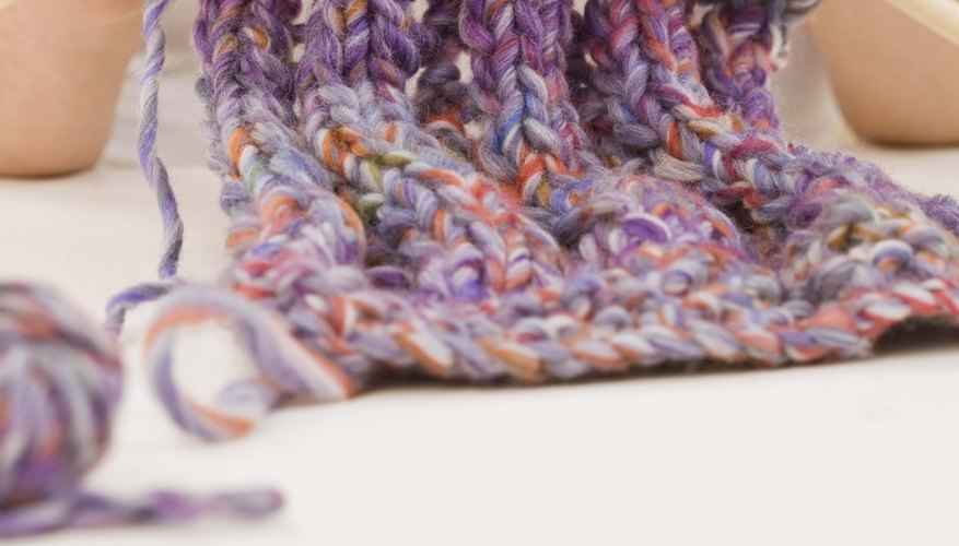 Quickly knit a cowl with chunky yarn and large knitting needles.