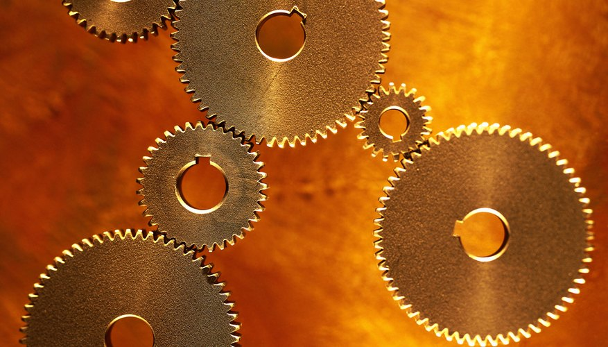 toned view of an array of gear wheels