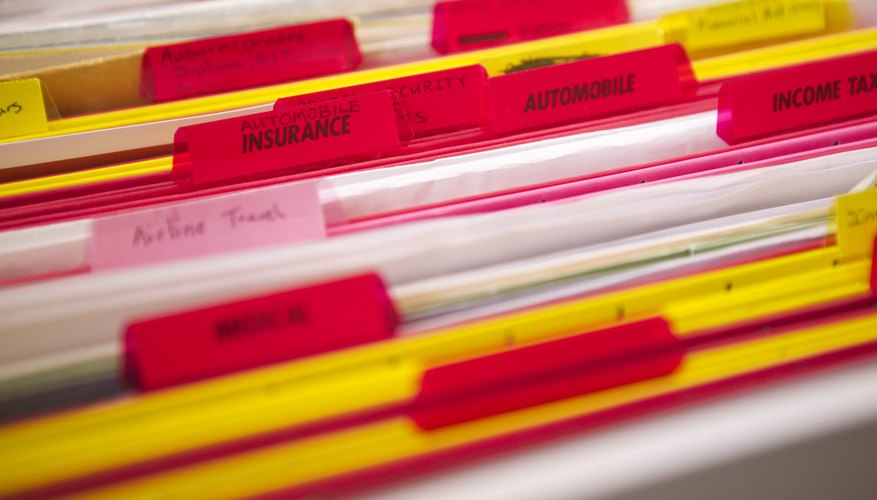 Extreme close-up of color coded file folders in a drawer