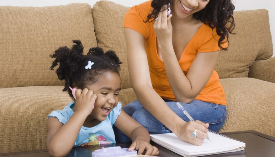 Play pretend on the phone with your child to help develop phone skills.