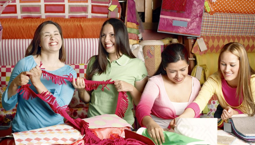Women with fabric samples