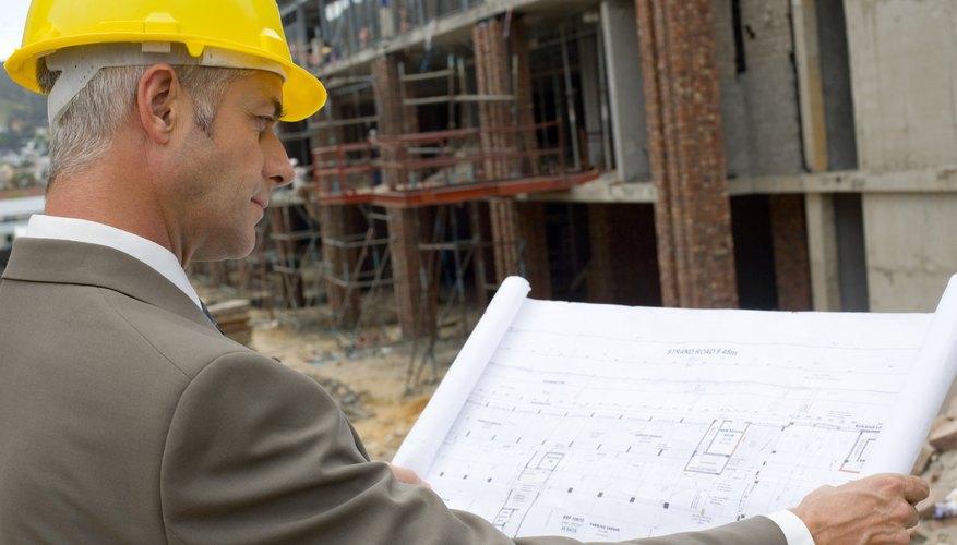 Architect reading blueprints at construction site
