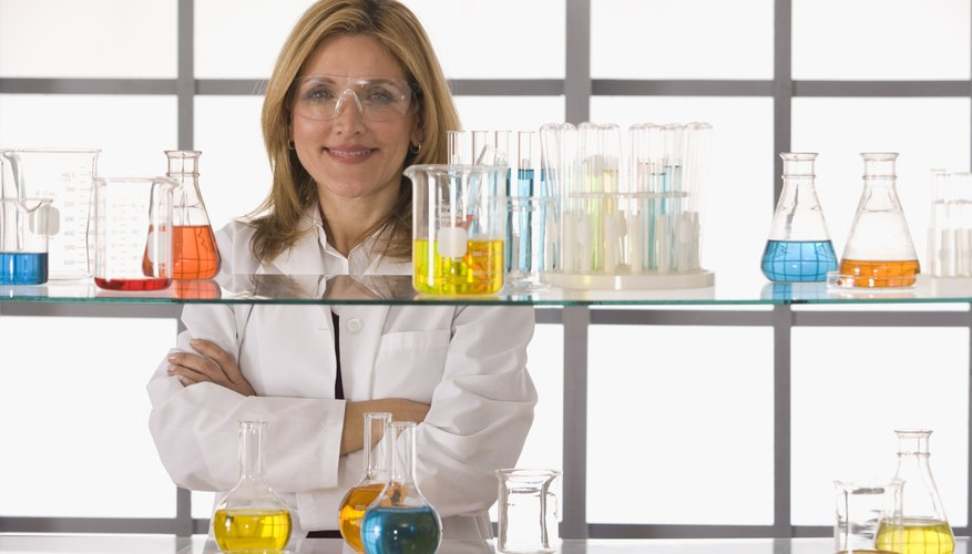 A smiling woman in a chemistry lab.