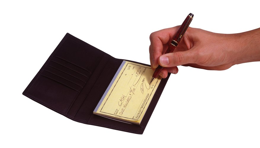 Hand signing a check