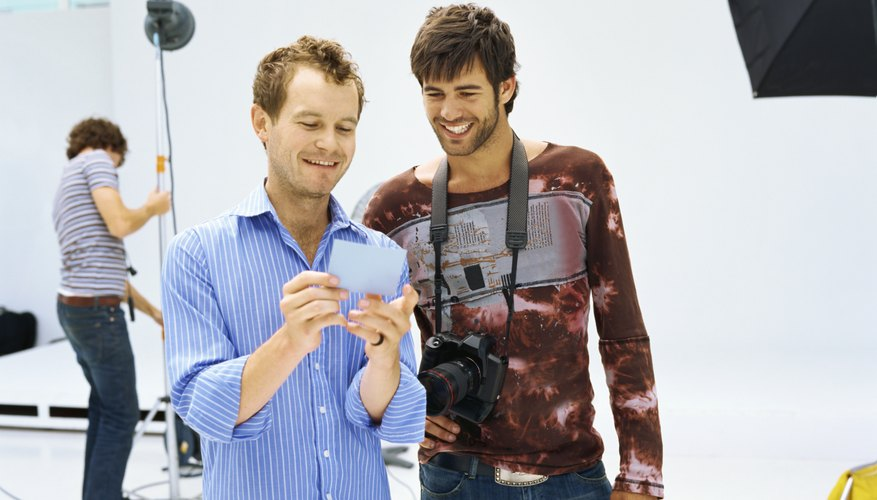 Two young men looking at a photograph