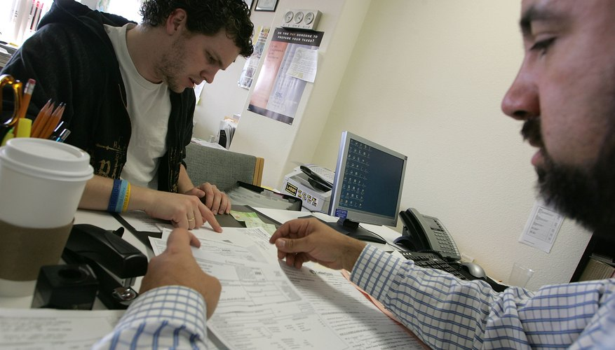 You may hire a tax professional to help you figure and file your taxes.