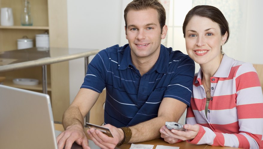 Couple with credit card and laptop