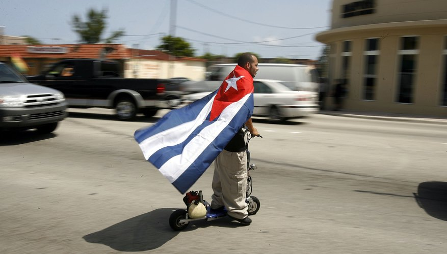 Cuban fan riding motorized scooter