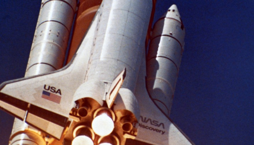 Aerospace engineers design spacecraft like the space shuttle.