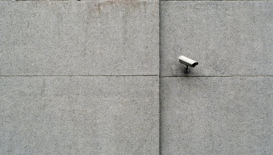 Close-up of a security camera on a wall