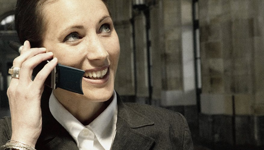 Businesswoman smiling on cell phone