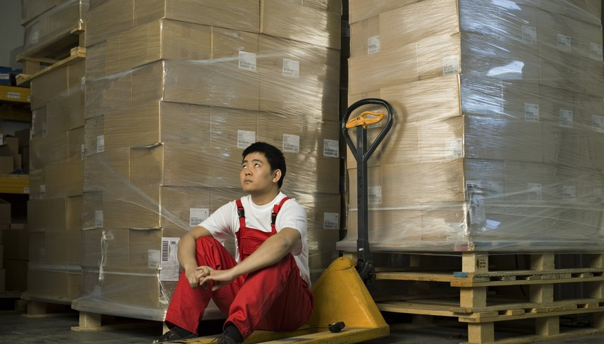 Worker sitting in warehouse