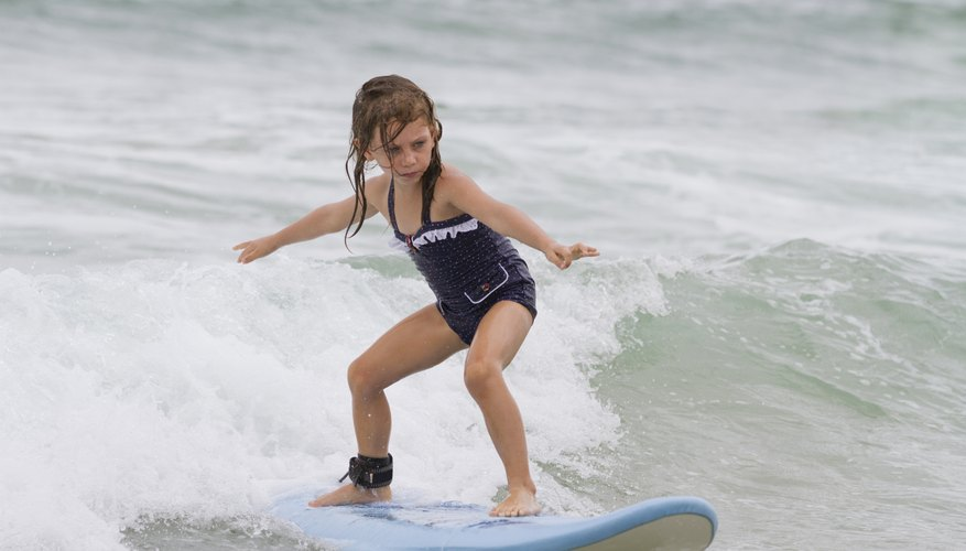 Young girl surfing a wave.