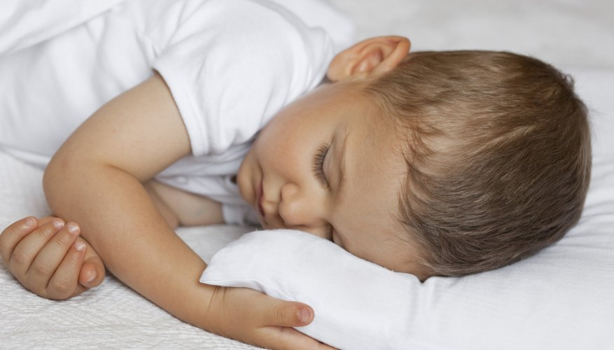 toddler napping in bed