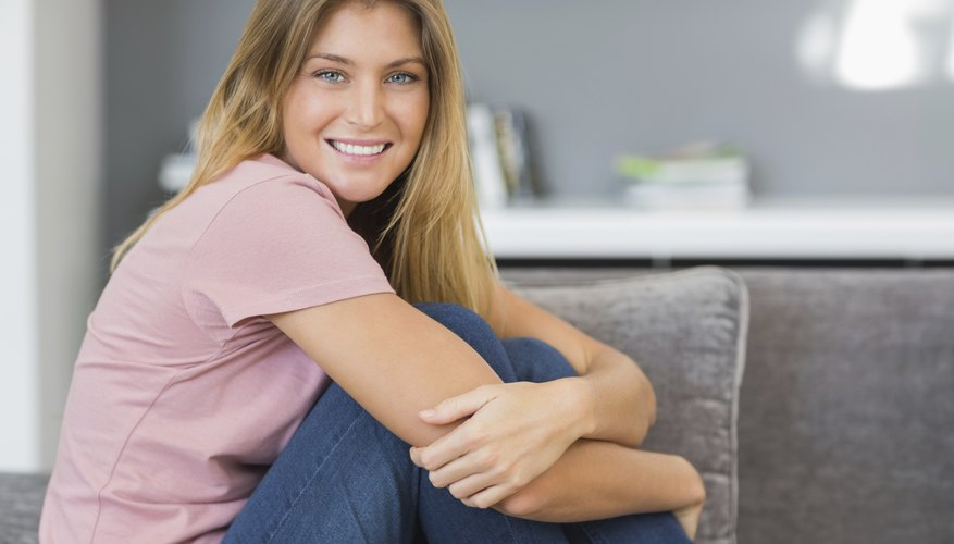 Woman sitting on couch in bachelor pad