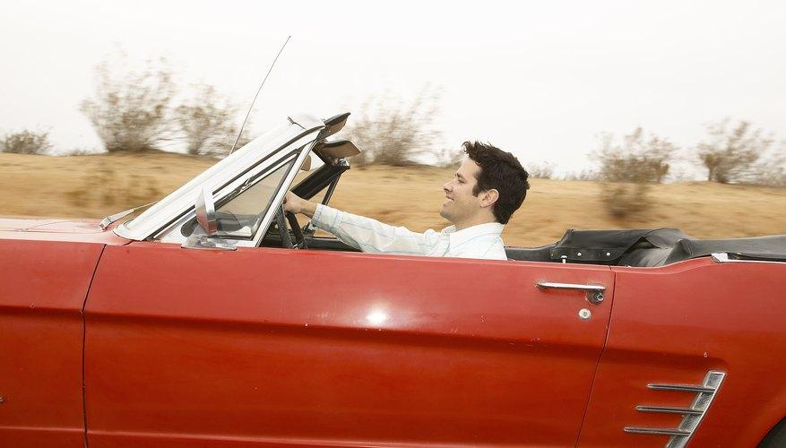 Pulsa el botón convertible hacia delante para abrir la capota.