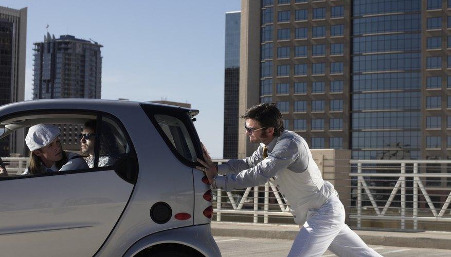 man pushing electric car