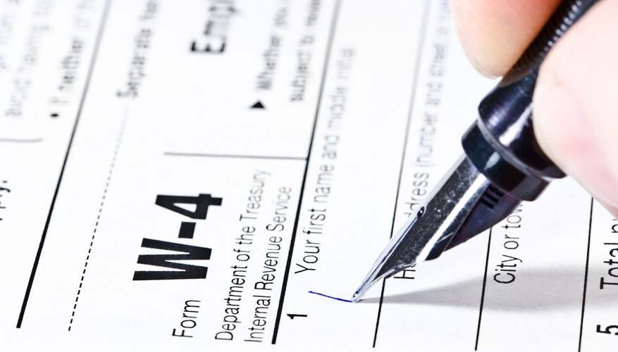 Pen writing on a W-4 form