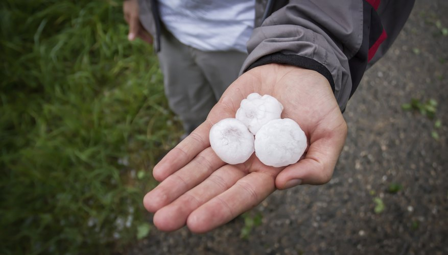 A man holding some hail in his hands.